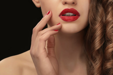 Beautiful young woman on dark background, closeup