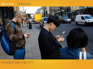 The Wider Image: Phones and the city