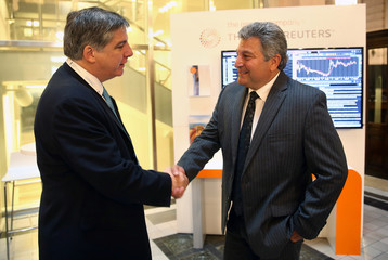 Steve St. Angelo, Toyota Latin America CEO, shakes hands with Lissarrague, Thomson Reuters GGO President, during an interview with Reuters at the Argentina Business and Investment Forum 2016 in Buenos Aires