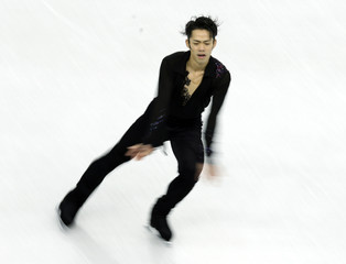 Takahashi of Japan performs during the men's free skating competition at the ISU Grand Prix of Figure Skating Final in Sochi