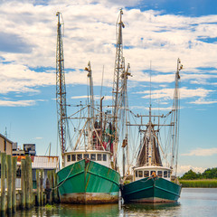 Shrimp boats docked along the river