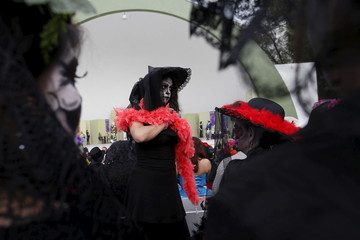 "A woman with her face painted to look like the popular Mexican figure called ""Catrina"", takes part in the annual Catrina Fest in Mexico City"