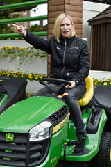 Britain's Zara Phillips sits on a lawn mower at the Royal Horticultural Soceity's Chelsea Flower Show in London