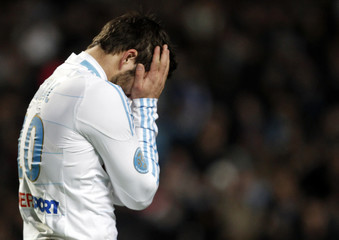 Olympique Marseille's Gignac reacts after missing a scoring opportunity during their French Ligue 1 soccer match at the Velodrome stadium in Marseille