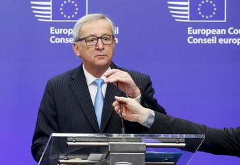 A microphone is adjusted for remarks of EU Commission President Juncker ahead of an EU leaders summit over migration in Brussels