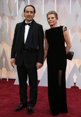 Alexandre Desplat, double nominee for best original score, arrives with his wife Dominique at the 87th Academy Awards in Hollywood