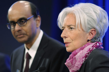 IMF MD Lagarde and IMFC Chairman Shanmugaratnam give remarks at a news conference for the IMFC committee meeting during the semi-annual meetings of the IMF and the World Bank in Washington