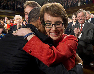 U.S. President Barack Obama hugs Representative Giffords  prior to his State of the Union address to a joint session of Congress on Capitol Hill in Washington,