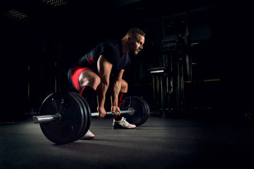 Athlete is prepared to perform an exercise called deadlift