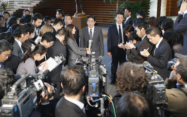 Japan's PM Abe speaks to reporters after hearing a briefing by Finance Minister Aso, Bank of Japan Governor Shirakawa and Economics Minister Amari in Tokyo
