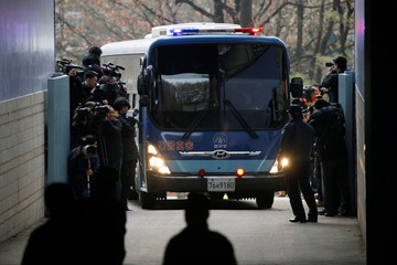 A bus transporting Choi Soon-sil arrives at a court in Seoul