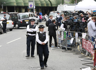 Police and media gather outside the Ecuador embassy in west London