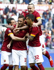 AS Roma's Totti celebrates with his teammates  Florenzi, Nainggolan and Paredes after scoring a penalty against Atalanta during their Serie A soccer match at the Olympic stadium in Rome