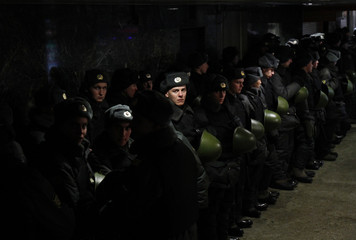 Interior Ministry officers stay warm as they stand guard in central Moscow