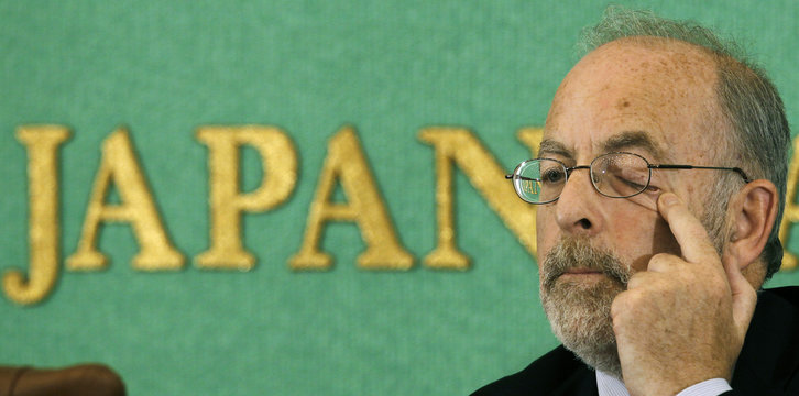 Ireland's Central Bank Governor Patrick Honohan rubs his eye during a news conference in Tokyo