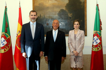 Portugal's President Marcelo Rebelo de Sousa poses for a photograph with Spain's King Felipe and Queen Letizia during official welcoming ceremonies at the start of their official visit in Porto