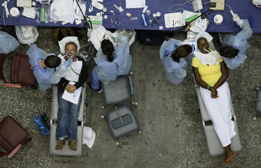 People receive dental treatment at the Care Harbor/LA free clinic in Los Angeles