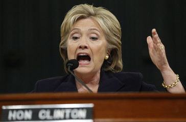 U.S. Democratic presidential candidate Clinton reacts as she testifies before House Select Committee on Benghazi in Washington