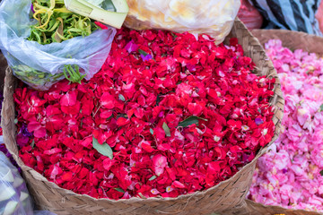 Canang sari flowers background, traditional balinese market, Bali, Indonesia.