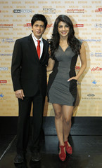"""Indian actor Khan and actress Chopra pose during a photocall to promote their movie """"Don-2"""" in Berlin"""