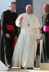 Pope Francis waves as he arrives for the Way of the Cross with the young people gathered at Blonia Park in Krakow