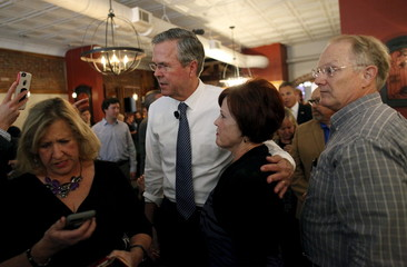 "U.S. Republican presidential candidate and former Florida Governor Jeb Bush poses for photos at a ""meet and greet"" event at Wholly Smokin' BBQ in Florence"