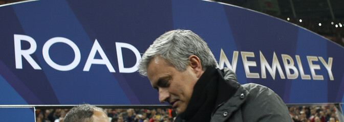 Real Madrid's coach Mourinho walks off the pitch at the end of their Champions League quarter-final second leg soccer match against Galatasaray in Istanbul