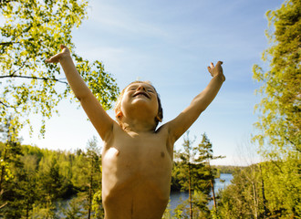 little cute real boy among tree hight, outdoor lifestyle people