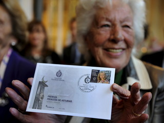 Maria del Carmen Alvarez del Valle great-grandmother of Leonor, Princess of Asturias poses with a postage stamp featuring the princess in Oviedo