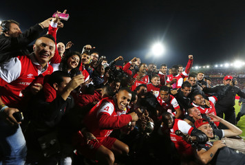 Santa Fe's soccer players celebrate with their trophies after beating Medellin to win the Colombian first division championship in Bogota