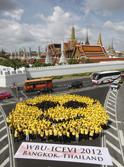 """Hundreds of visually impaired people and volunteers form a """"blind smiley face"""" during the """"happy smile blind event"""" outside the Wat Phra Kaew Temple of the Emerald Buddha in Bangkok"""