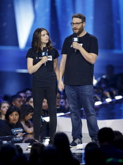 Actors Seth Rogen and Lauren Miller Rogen talk on stage during We Day California in Inglewood