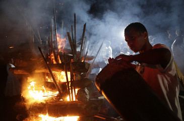 A youth plays a tambor during a Jongo performance at the community of Quilombo Sao Jose, descendants of African slaves, during a Afro-Brazilian culture celebration marking the anniversary of the abolition of slavery, in Valenca