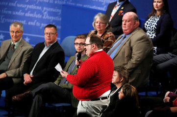 Ken Bone stands to ask a question about energy policy and jobs to Republican U.S. presidential nominee Donald Trump and Democratic nominee Clinton during their debate at Washington University in St. Louis