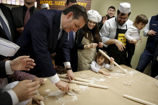 U.S. Republican presidential candidate Ted Cruz  and children make the traditional Jewish bread, matzah at a campaign event in the Brooklyn borough of New York