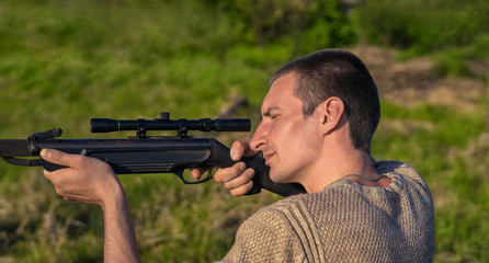The man takes aim at the target with a retro sniperl rifle. Selective Focus