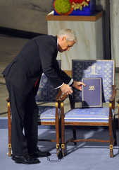 The Norwegian Nobel Committee chairman Jagland puts the diploma on the empty chair where Nobel Peace Prize winner Liu Xiaobo should sit during the Nobel Peace Prize ceremony in Oslo