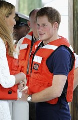 Britain's Prince Harry talks to family friend India Hicks during a visit to Harbour Island in Nassau, Bahamas