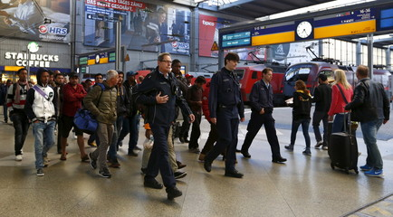 Migrants arrive at the main railway station in Munich