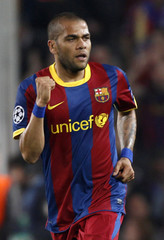 Barcelona's Alves celebrates after scoring against Shakhtar Donetsk during the first leg of their Champions League quarter-final soccer match in Barcelona