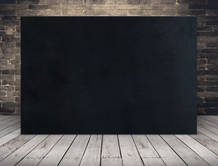 Blank long Black paper poster at grunge brick wall and plank wood floor,Mock up template for adding...