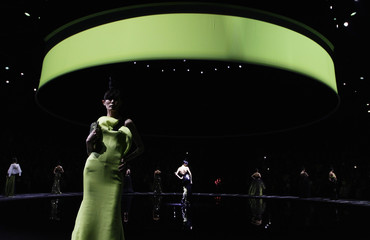 Models present creations for the Giorgio Armani fashion show in Beijing