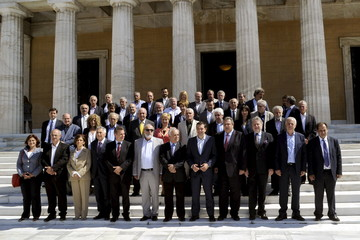 Greek Prime Minister Tsipras and members of the new government pose for a group picture after the first meeting of the new cabinet at the parliament building in Athens