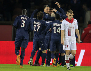 Paris Saint-Germain's players celebrate after scoring against Lille during their French Ligue 1 soccer match at Parc des Princes stadium in Paris