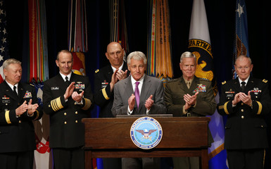 Chuck Hagel joins the applause during a signing ceremony for the Department of Defense Human Goals Charter at the Pentagon in Washington