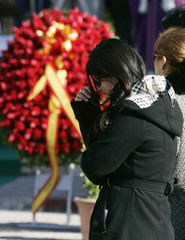 Relatives of Spanish soldier Romero Meneses, who was killed in Afghanistan, react during a funeral ceremony in Barcelona