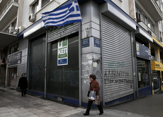 Greek flag flutters outside a Citizen's Service Center in Athens