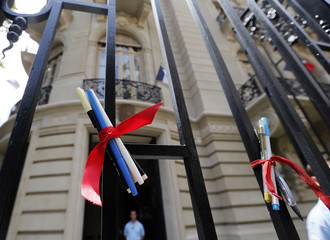 Pencils tied with a red ribbon are seen on a fence at the French Embassy during a tribute to the victims of the shootings by gunmen at the offices of the satirical weekly newspaper Charlie Hebdo, in Buenos Aires