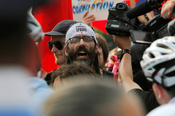 A man yells at police from behind a police barricade during a protest at the Wells Fargo Center during the Democratic National Convention in Philadelphia, Pennsylvania, U.S.