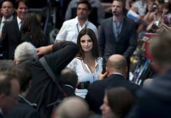 """Spanish actress Penelope Cruz poses for photographers as he arrives for the premiere of her new film """"Pirates of the Caribbean: On Stranger Tides"""" at the Westfield Cinema in London"""